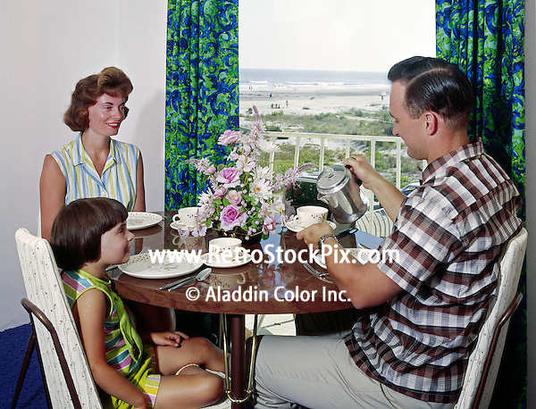 Man pouring his wife coffee in their motel room at the Shalimar Motel in Wildwood New Jersey. Retro 1960's photograph.