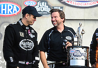 Nov. 13, 2011; Pomona, CA, USA; NHRA top fuel dragster driver Larry Dixon (left) and Del Worsham with the championship trophy during the Auto Club Finals at Auto Club Raceway at Pomona. Mandatory Credit: Mark J. Rebilas-.