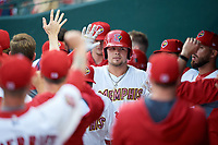 Memphis Redbirds first baseman Luke Voit (35) high fives with his teammates in the dugout after hitting a home run in the bottom of the first inning during a game against the Round Rock Express on April 28, 2017 at AutoZone Park in Memphis, Tennessee.  Memphis defeated Round Rock 9-1.  (Mike Janes/Four Seam Images)