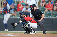 Kannapolis Intimidators catcher Michael Hickman (16) sets a target as home plate umpire Sean Cassidy looks on during the game against the Rome Braves at Kannapolis Intimidators Stadium on July 3, 2019 in Kannapolis, North Carolina.  The Braves defeated the Intimidators 13-11, (Brian Westerholt/Four Seam Images)