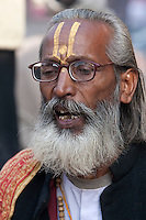 Pashupatinath, Nepal.  Sadhu (Holy Man) Singing at Nepal's Holiest Hindu Temple.  The trident on his forehead marks him as a devotee of Shiva.