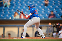 South Bend Cubs designated hitter Nelson Velazquez (36) squares around to bunt during the first game of a doubleheader against the Lake County Captains on May 16, 2018 at Classic Park in Eastlake, Ohio.  South Bend defeated Lake County 6-4 in twelve innings.  (Mike Janes/Four Seam Images)