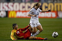 Rachel Buehler (26) of the USWNT is tackled by Li Danyang (14) of China during an international friendly at PPL Park in Chester, PA.  The U.S. tied China, 1-1.