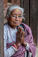 Bhaktapur, Nepal.  Old Newari Woman Making Namaste Gesture of Greeting.