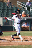 Salt River Rafters shortstop Jazz Chisholm (1), of the Arizona Diamondbacks organization, follows through on his swing during an Arizona Fall League game against the Glendale Desert Dogs at Salt River Fields at Talking Stick on October 31, 2018 in Scottsdale, Arizona. Glendale defeated Salt River 12-6 in extra innings. (Zachary Lucy/Four Seam Images)