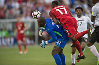 Commerce City, CO - Thursday June 08, 2017: Jan-Michael Williams, Jozy Atlidore during a 2018 FIFA World Cup Qualifying Final Round match between the men's national teams of the United States (USA) and Trinidad and Tobago (TRI) at Dick's Sporting Goods Park.