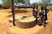 Kapatu, Zambia, Africa. Children standing by the village well.