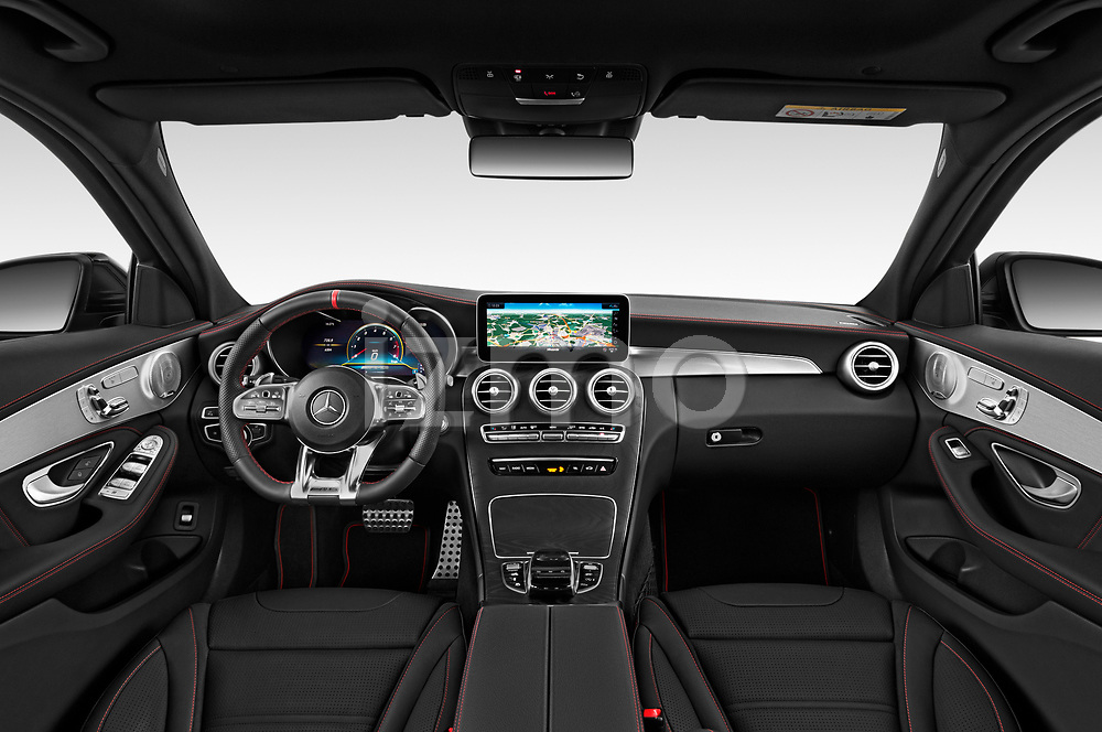 Stock photo of straight dashboard view of a 2020 Mercedes Benz C Class Break 43 AMG 5 Door Wagon