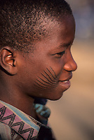 Zinder, Niger.  Young Hausa Man Showing Traditional Tribal Facial Scarification.