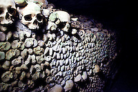 """Skulls line the walls in the Ossuaire Municipal of Paris, France aka the """"Catacombs"""", on June 13, 2010."""