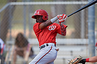 Washington Nationals Edwin Lora (10) follows through on a swing during a minor league Spring Training game against the St. Louis Cardinals on March 27, 2017 at the Roger Dean Stadium Complex in Jupiter, Florida.  (Mike Janes/Four Seam Images)