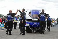 Aug. 21, 2011; Brainerd, MN, USA: NHRA crew members for funny car driver Melanie Troxel during the Lucas Oil Nationals at Brainerd International Raceway. Mandatory Credit: Mark J. Rebilas-