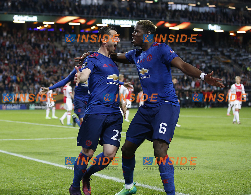 Henrikh Mkhitaryan of Manchester United ManU celebrates scoring the second goal with Paul Pogba of Manchester United during the UEFA Europa League Final match at the Friends Arena, Stockholm. Picture date: May 24th, 2017.Picture credit should read: Matt McNulty/Sportimage/Imago/Insidefoto