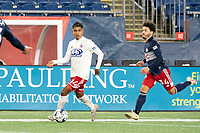 FOXBOROUGH, MA - OCTOBER 16: Gibran Rayo #14 of North Texas SC prepares to pass as Ryan Spaulding #34 of New England Revolution II pressures during a game between North Texas SC and New England Revolution II at Gillette Stadium on October 16, 2020 in Foxborough, Massachusetts.