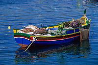Mgarr, Gozo, Malta.  Luzzu, Maltese Fishing Boat, in Harbor.