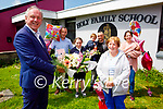 Kathleen Roche from Tralee retiring after 14 years as a cleaner in Holy Family NS been presented with flowers by principal Ed O'Brien.  Front l to r: Ed O'Brien and Kathleen Roche. Back l to r: Kevin, Ciara Marie, Dylan and Jonathan Roche, Evonne Joy and Cory Roche.