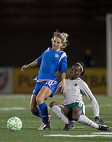 St Louis Athletica forward Enoila Aluko (9) challenges Boston Breakers defender Sue Weber (20). The Boston Breakers defeated Saint Louis Athletica, 2-0, at Harvard Stadium on April 11, 2009.