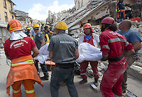 Operators rescue a corpse from rubble of collapsed building in the village of Amatrice, central Italy, hit by a magnitude 6 earthquake at 3,36 am, 24 August 2016.<br /> Operatori recuperano un cadavere tra le macerie degli edifici crollati dopo il terremoto che alle 3,36 del mattino ha colpito Amatrice, 24 agosto 2016.<br /> UPDATE IMAGES PRESS/Riccardo De Luca