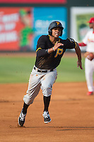 Trae Arbet (7) of the Bristol Pirates hustles towards third base against the Johnson City Cardinals at Howard Johnson Field at Cardinal Park on July 6, 2015 in Johnson City, Tennessee.  The Pirates defeated the Cardinals 2-0 in game one of a double-header. (Brian Westerholt/Four Seam Images)
