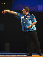 21.12.2014.  London, England.  William Hill World Darts Championship.  John Michael [GRE] in action during his game with Ian White (15) [ENG].