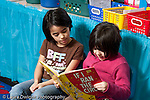 Education Elementary school Grade 2 two girls reading a book together horizontal