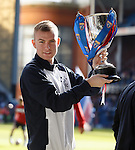 Andy Mitchell parades the reserve league cup around Ibrox