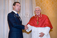 Russian President Dmitry Medvedev (L) and Pope Benedict XVI shake hands as they meet in Vatican DECEMBER 3, 2009.