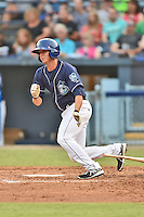 Asheville Tourists designated hitter  Ashley Graeter #6 swings at a pitch during a game against the Kannapolis Intimidators at McCormick Field on June 7, 2014 in Asheville, North Carolina. The Tourists defeated the Intimidators 7-5. (Tony Farlow/Four Seam Images)