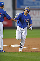 Javy Baez #12 of the Iowa Cubs rounds third base after hitting a home run against the New Orleans Zephyrs at Principal Park on July  24, 2014 in Des Moines, Iowa. The Cubs won 11-2.   (Dennis Hubbard/Four Seam Images)