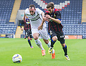 Raith's Mark Stewart and Caley's Graeme Shinnie challenge for the ball.