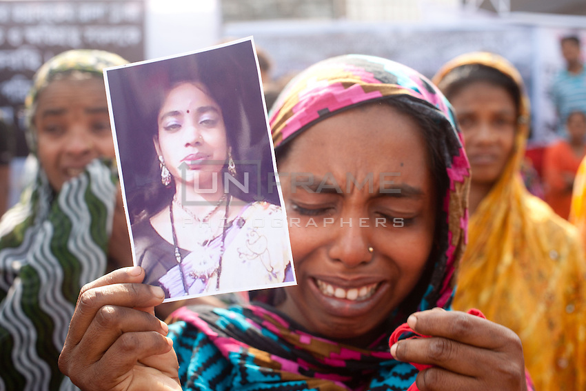 Relatives of victims with thousands of people gather at the Rana Plaza collapse site today to commemorate the tragedy that happened one year ago. Rana Plaza, the eight-storey building collapsed, leaving 1135 people dead, mostly garment factory workers in this day in 2013. The search for the dead ended on May 31 with dead toll of 1135. Approximately 2515 injured people were rescued from the building alive. More than 100 workers are still missing. Savar, near Dhaka, Bangladesh.