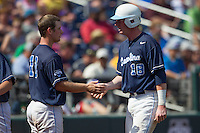 North Carolina third baseman Colin Moran (18) is greeted by teammate Brian Holberton (10) after he scored in the seventh inning against the Louisiana State Tigers during Game 7 of the 2013 Men's College World Series on June 18, 2013 at TD Ameritrade Park in Omaha, Nebraska. The Tar Heels defeated the Tigers 4-2, eliminating LSU from the tournament. (Andrew Woolley/Four Seam Images)