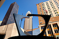 A piece of abstract art makes for interesting symmetry with the surrounding buildings in downtown Charlotte, NC.