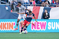 FOXBOROUGH, MA - JULY 25: Carles Gil #22 of New England Revolution breaks free from Mason Toye #13 of CF Montreal during a game between CF Montreal and New England Revolution at Gillette Stadium on July 25, 2021 in Foxborough, Massachusetts.