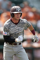 Texas A&M Aggies outfielder Tyler Naquin #18 runs to first base during the NCAA baseball game against the Texas Longhorns on April 29, 2012 at UFCU Disch-Falk Field in Austin, Texas. The Longhorns beat the Aggies 2-1 in the last ever regular season game scheduled for the long time rivals. (Andrew Woolley / Four Seam Images).