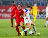 CARSON, CA - FEBRUARY 07: Desiree Scott #11 of Canada fouls Gloriana Villalobos #9 of Costa Rica during a game between Canada and Costa Rica at Dignity Health Sports Park on February 07, 2020 in Carson, California.