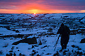 04/02/15<br /> <br /> With no end in sight for the freezing conditions gripping the country a photographer sets up her tripod to capture every moment of an awe-inspiring sunset over The Roaches in the Staffordshire Peak District near Leek.<br /> <br /> All Rights Reserved - F Stop Press.  www.fstoppress.com. Tel: +44 (0)1335 418629 +44(0)7765 242650
