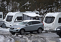 """28/03/16 <br /> <br /> Snow-covered 4x4 tows leaves camp site after snowfall in Buxton. <br /> <br /> Holiday makers camping in the Derbyshire Peak District woke up to an unexpected white blanket this morning, thanks to Storm Katie.<br /> The covering of snow meant that many campers cut short their plans for a long weekend away, to brave the icy roads and head home early on Monday morning.<br /> But it wasn't all bad news for some of the younger guests at Grin Low Caravan Site in Buxton.<br /> Three-year-old Greta Williams made the most of the morning's surprise by building a snowman and enjoying snowball fights with her aunt Claire Jones. <br /> Claire said it was the first time she had been camping in the snow. <br /> """"It was completely unexpected but it's made it a trip to remember,""""she said. <br /> """"Greta really enjoyed making the snowman, but I think we'll head back home now in case any more falls.""""<br /> For Chris and Lorraine McCoy the first they knew of the snow was when they woke up and stuck their heads out of their tent.<br /> They had travelled to Buxton from Warwickshire with their four-year-old son Joe, to enjoy a weekend break.<br /> """"It's all part of the adventure,"""" said Chris. """"It's a bit cold in the tent but we'll soon warm up, and it's made the surrounding countryside really beautiful.""""<br /> <br /> All Rights Reserved: F Stop Press Ltd. +44(0)1335 418365   +44 (0)7765 242650 www.fstoppress.com"""