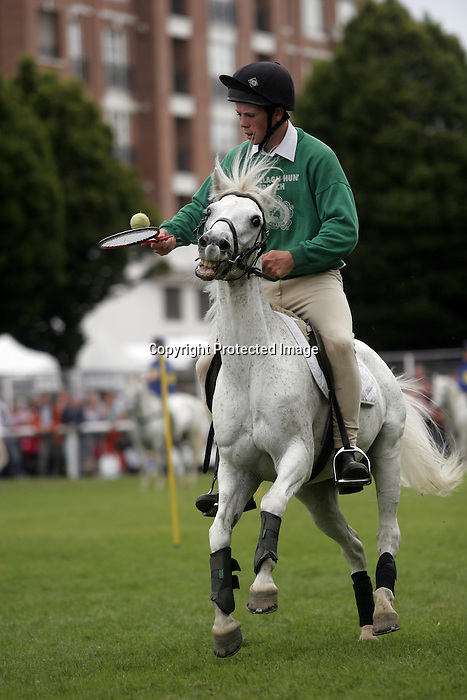 August 09, 2009: A competitor in the pony speed obstacle course event. Longines International Grand Prix. Failte Ireland Horse Show. The RDS, Dublin, Ireland.