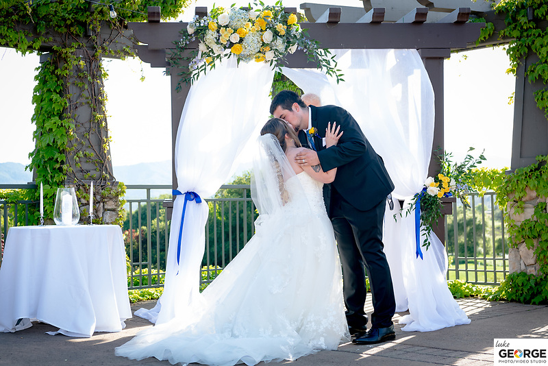 Jared and Emma Imboden celebrate their wedding ceremony in the Wedgewood Weddings venue at Novato's Stonetree Golf Club 4/26/21.