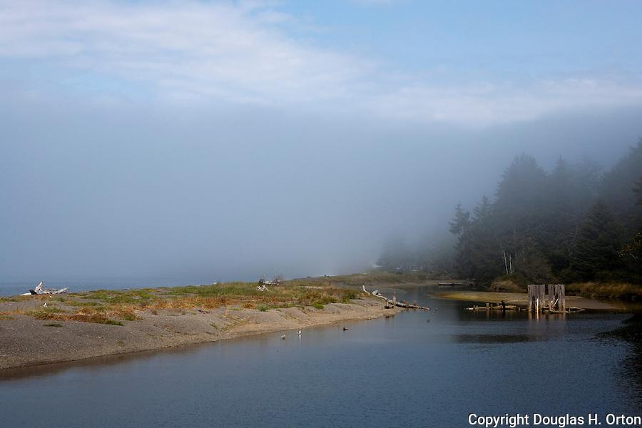 Fog shrouds Clallam Bay Spit County Park in the town of Clallam just east of Sekiu, Washington.  Clallam Bay, near the west end of the Strait of Juan de Fuca and the fishing community of Sekiu. Olympic Penninsula, Washington.  Outdoor Adventure. Olympic Peninsula