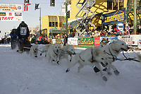 March 3, 2007   Jim Lanier leaves the 4th avenue start line during the Iditarod ceremonial start day in Anchorage