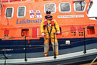 Royal National Lifeboat Institution crew aboard their Severn class, all weather type lifeboat. The coxswain is standing in front of the name plaque RNLB Richard Cox Scott. This image may only be used to portray the subject in a positive manner..©shoutpictures.com..john@shoutpictures.com