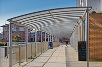 Pictured: A lone man walks under a shelter by the bus station in Swansea, Wales, UK. Thursday 26 March 2020<br /> Re: Covid-19 Coronavirus pandemic, UK.