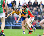 Shane Golden of Sixmilebridge in action against Shane Mc Namara of  Clooney-Quin during their senior county final at Cusack Park. Photograph by John Kelly.
