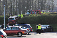 Pictured: Fire service personnel attend an incident in which a red Seat Alhambra car ended up on a grass bank at the Liberty Stadium, Wales, UK. Saturday 14 April 2018<br />