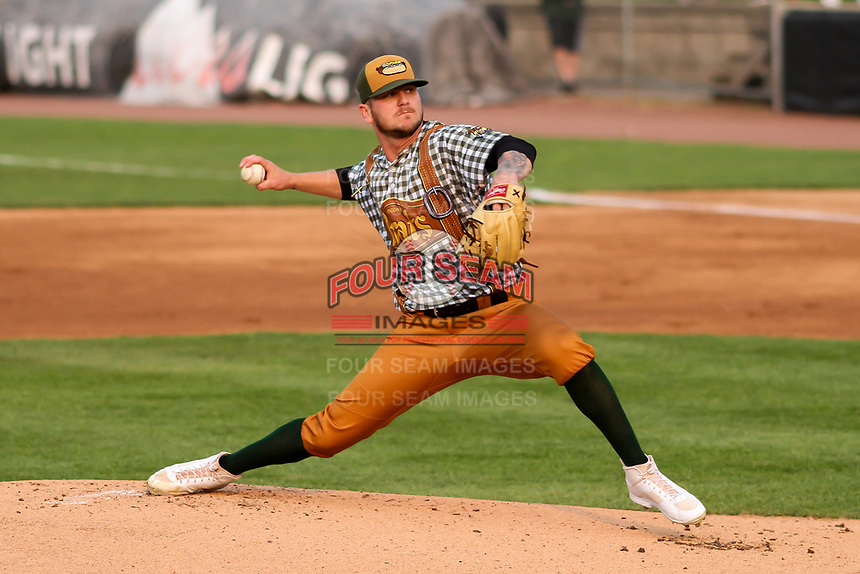 Wisconsin Timber Rattlers pitcher Logan Gillaspie (33) delivers a pitch during a Midwest League game against the Peoria Chiefs on May 31, 2019 at Fox Cities Stadium in Appleton, Wisconsin. Peoria defeated Wisconsin 3-0. (Brad Krause/Four Seam Images)