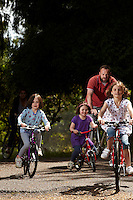 Family cycling , Grayshott , Hampshire  June 2011.pic copyright Steve Behr / Stockfile