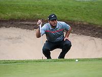 22.05.2015. Wentworth, England. BMW PGA Golf Championship. Round 2. Francesco Molinari [ITA] lines up a putt on the 18th Green.