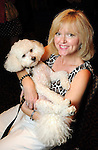"""Brenda Cheney with Frankie at the """"Dog Days of Summer"""" Yappy Hour benefitting Citizens for Animal Protection and Golden Beginnings Golden Retriever Rescue at Hotel Derek Wednesday July 21,2010.(Dave Rossman/For the Chronicle)"""